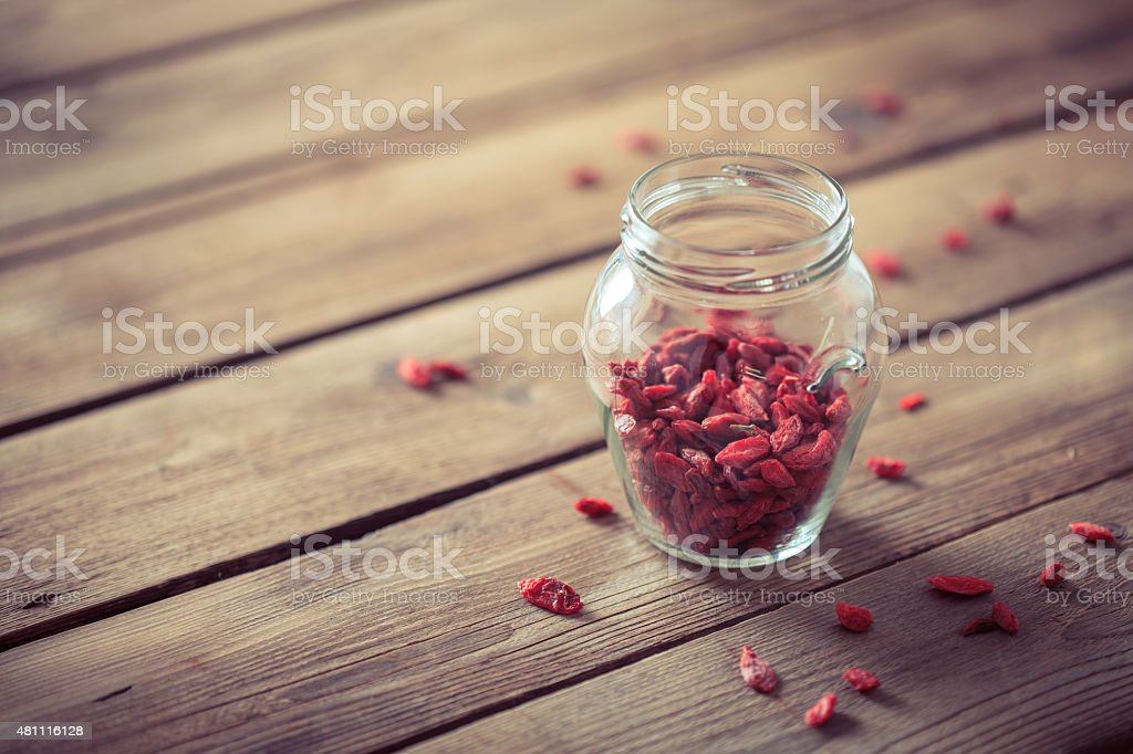 Goji berry (wolfberry) on wooden table stock photo