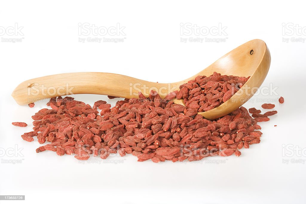 Goji berry with a wooden spoon royalty-free stock photo