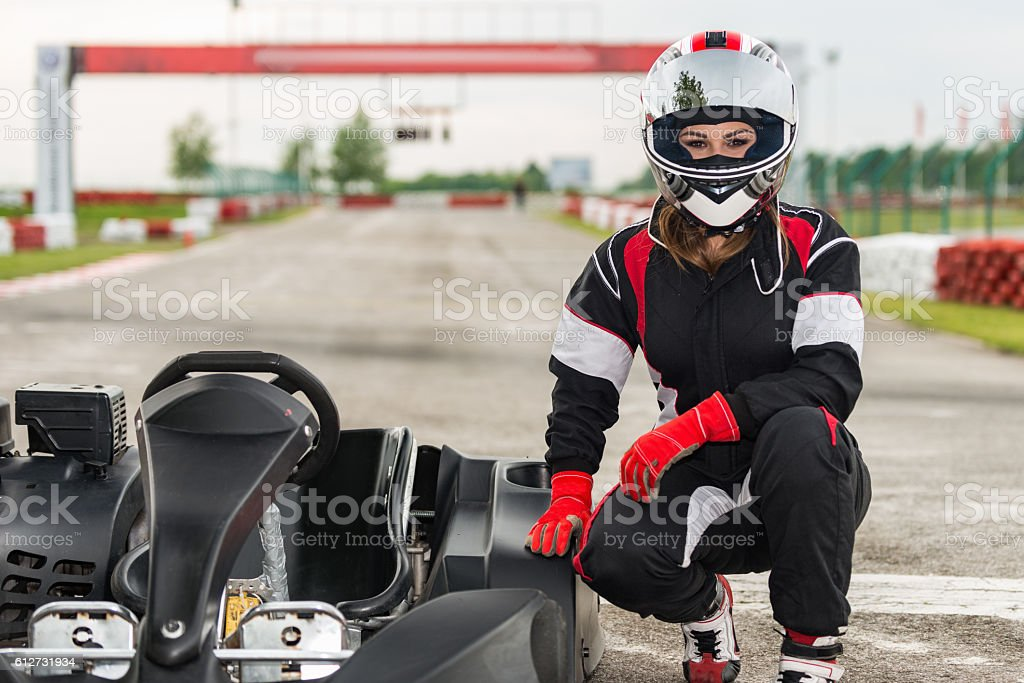 Go-karting. Female go-karting champion posing by her car stock photo