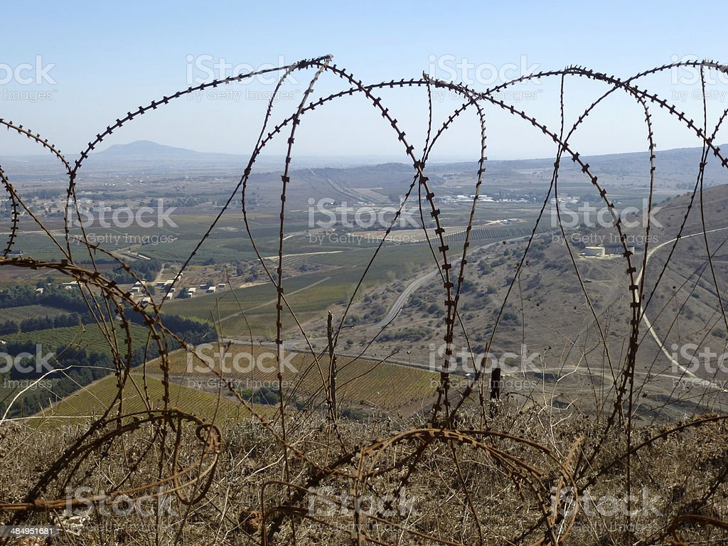 Golan Hights, View into Syria Through Barbed Wire stock photo