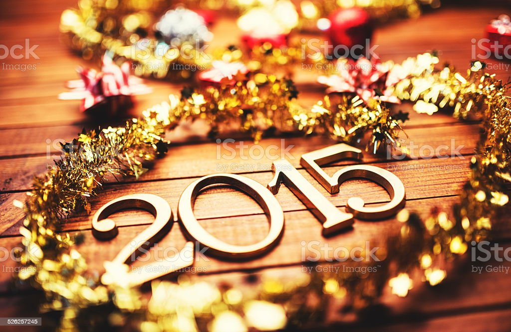Gold 2015 New year text on christmas decoration