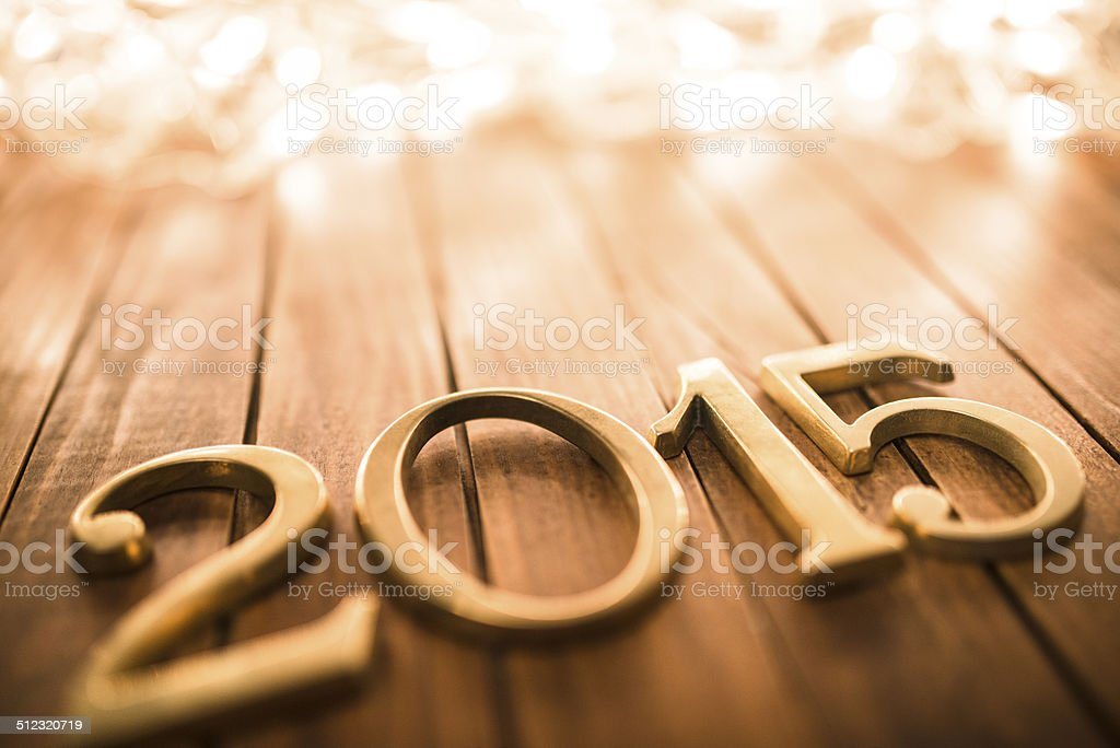 Gold 2015 New year text on plank wood stock photo
