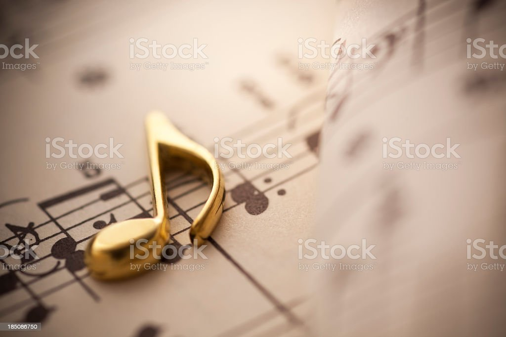Gold 3d music note on sheet music stock photo
