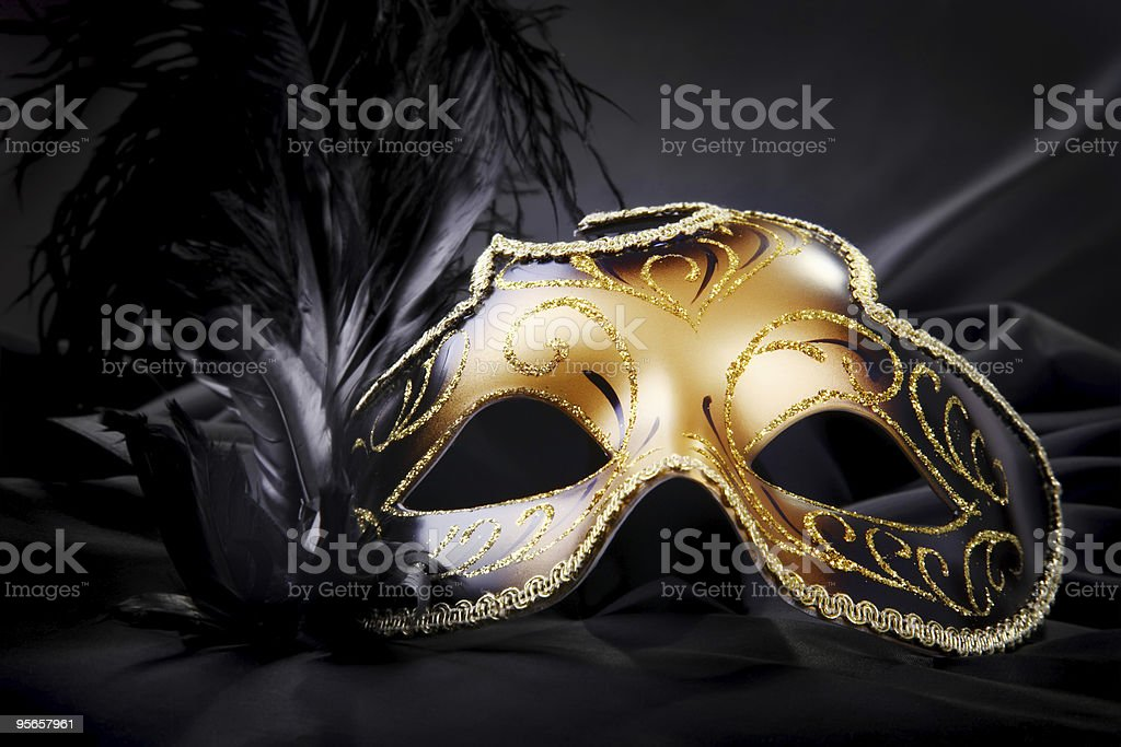 Gold and black ombre carnival mask stock photo