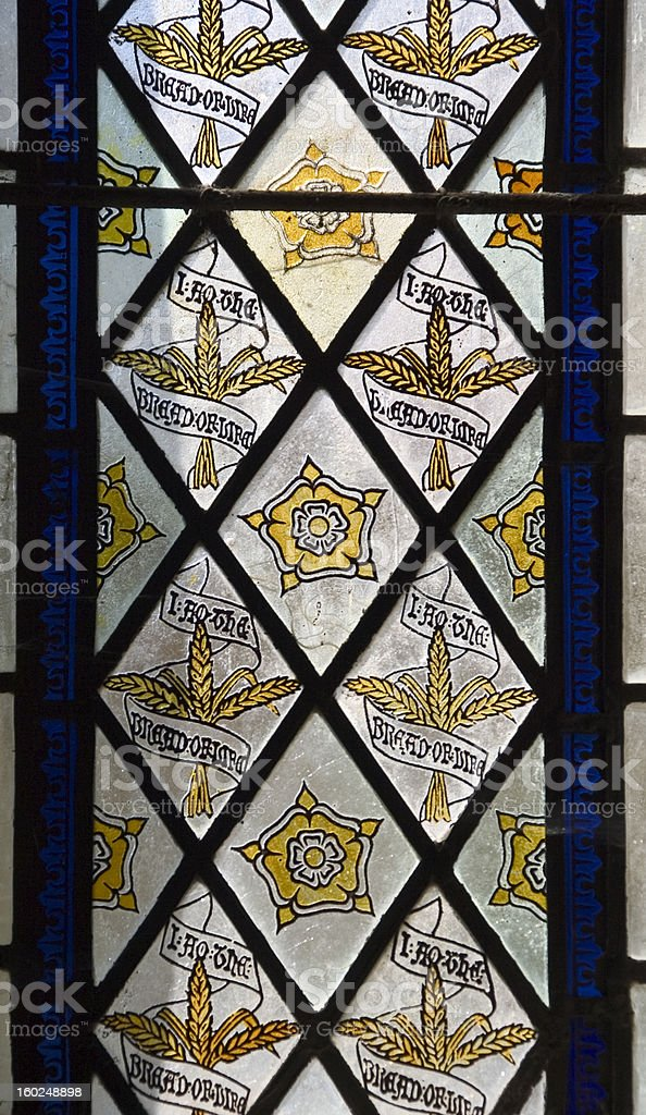Gold and blue stained glass window stock photo