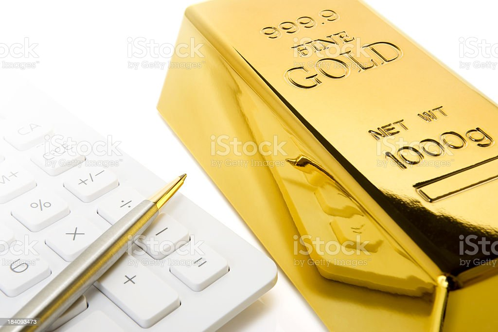 Gold and calculator royalty-free stock photo