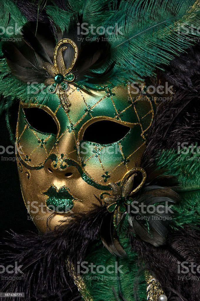 A gold and green masquerade mask stock photo