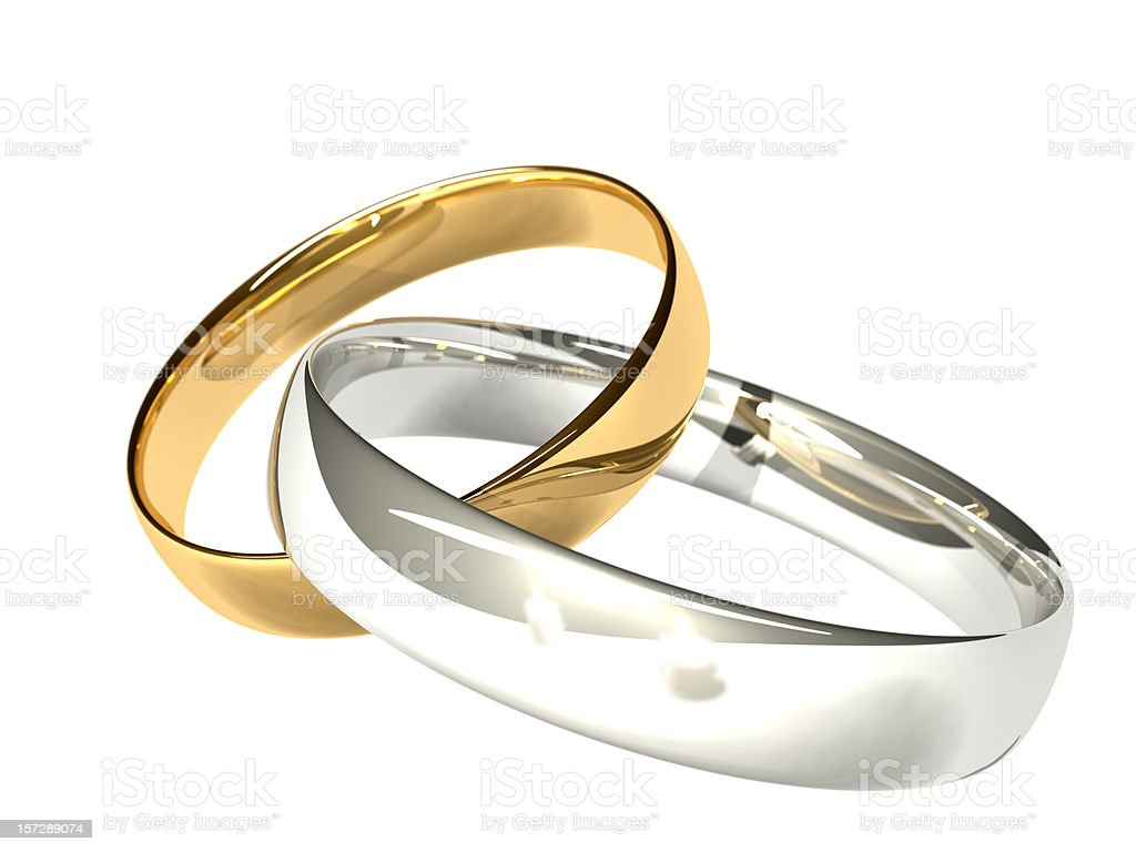 Gold and Platinum/Silver Wedding Rings - Reflected Candles royalty-free stock photo