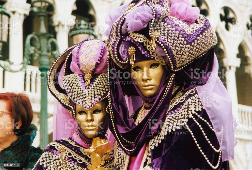 Gold and purple masked carnival creatures in Venice stock photo