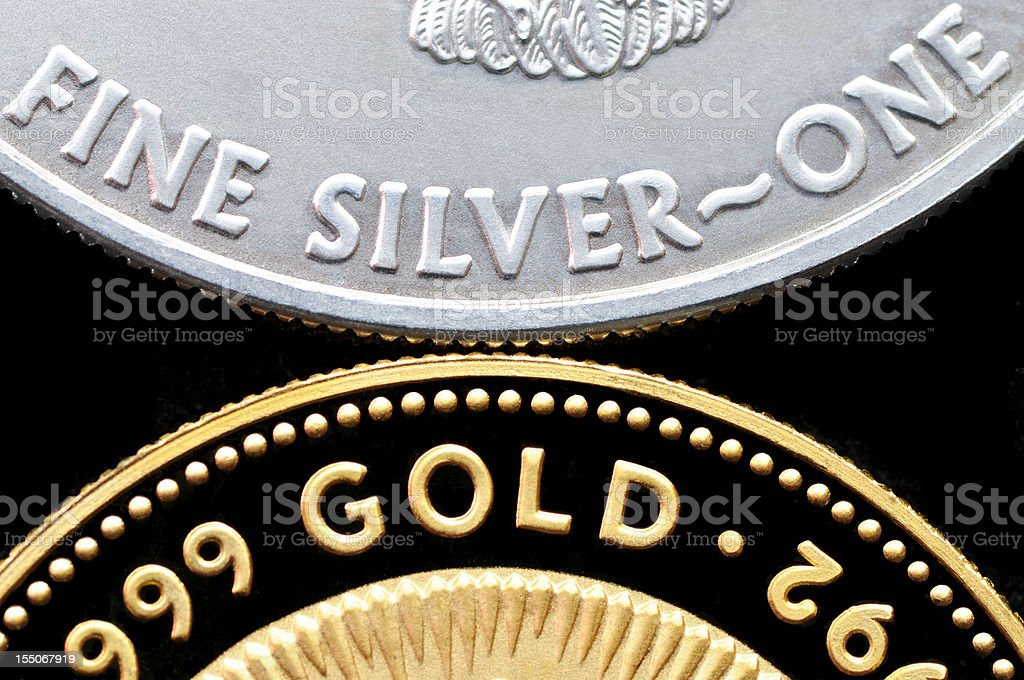 Gold and Silver Coins isolated on Black stock photo
