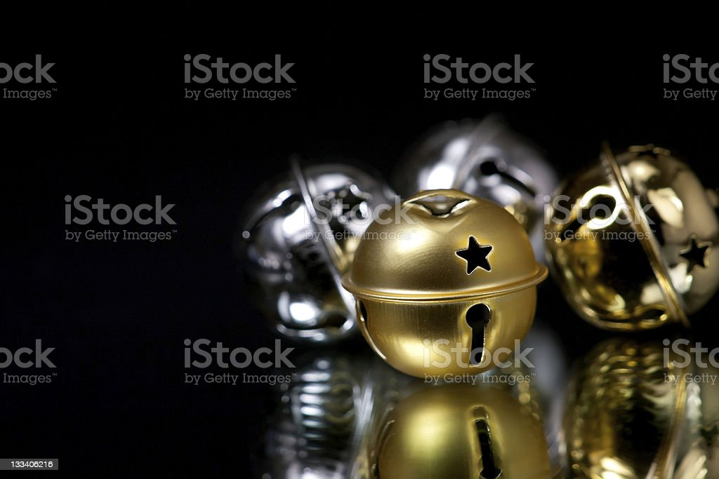 Gold and silver jingle bells for Christmas stock photo
