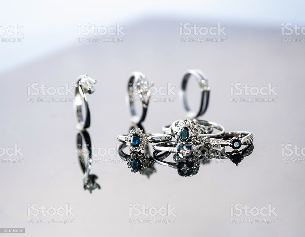 Gold and silver rings with gems in jewellry shop stock photo