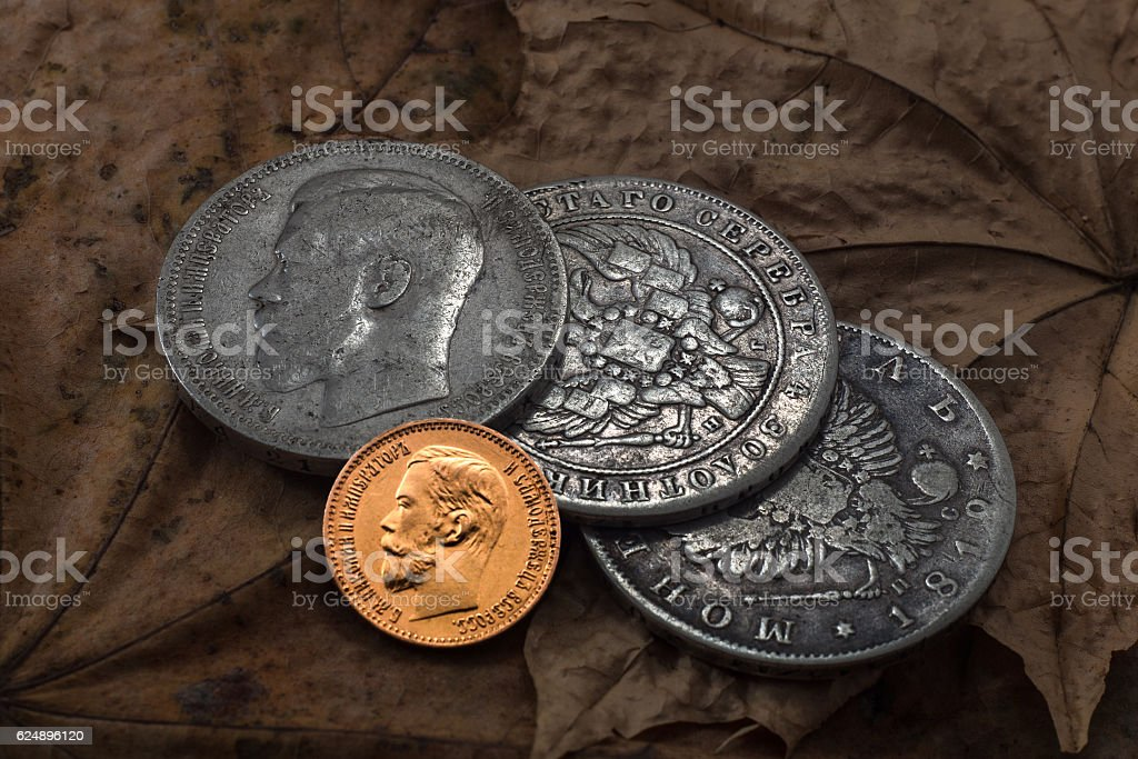 Gold and silver rubles stock photo