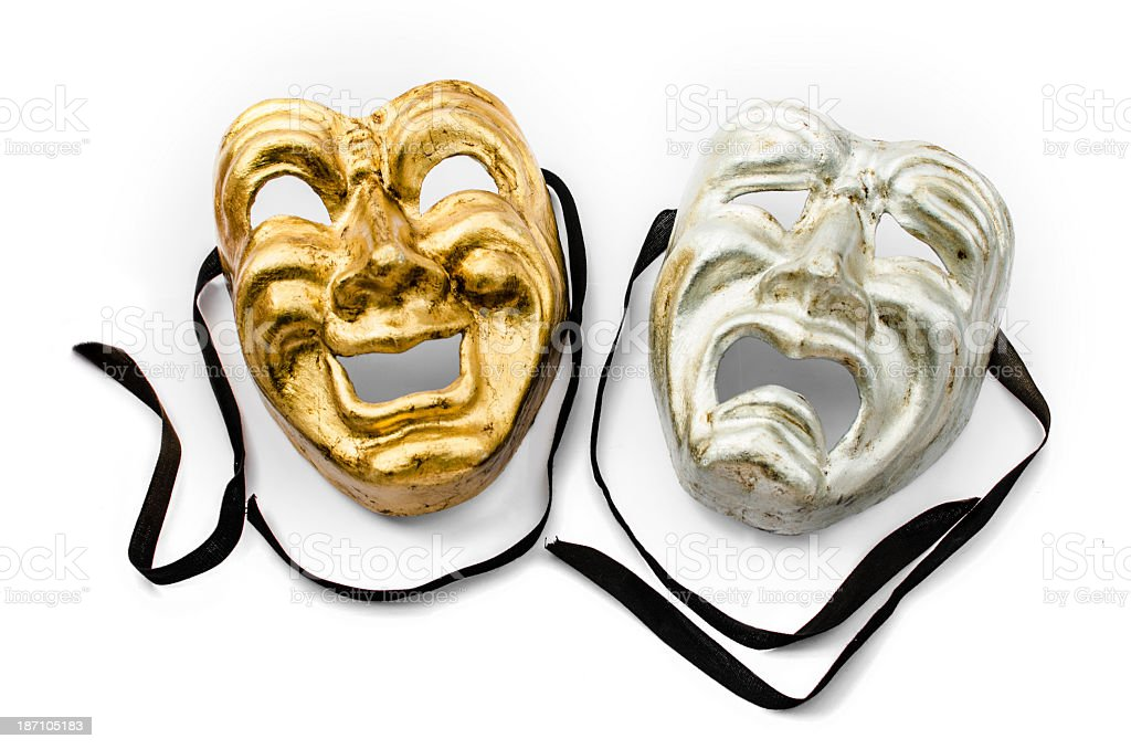 A gold and silver theater mask with black ribbons stock photo