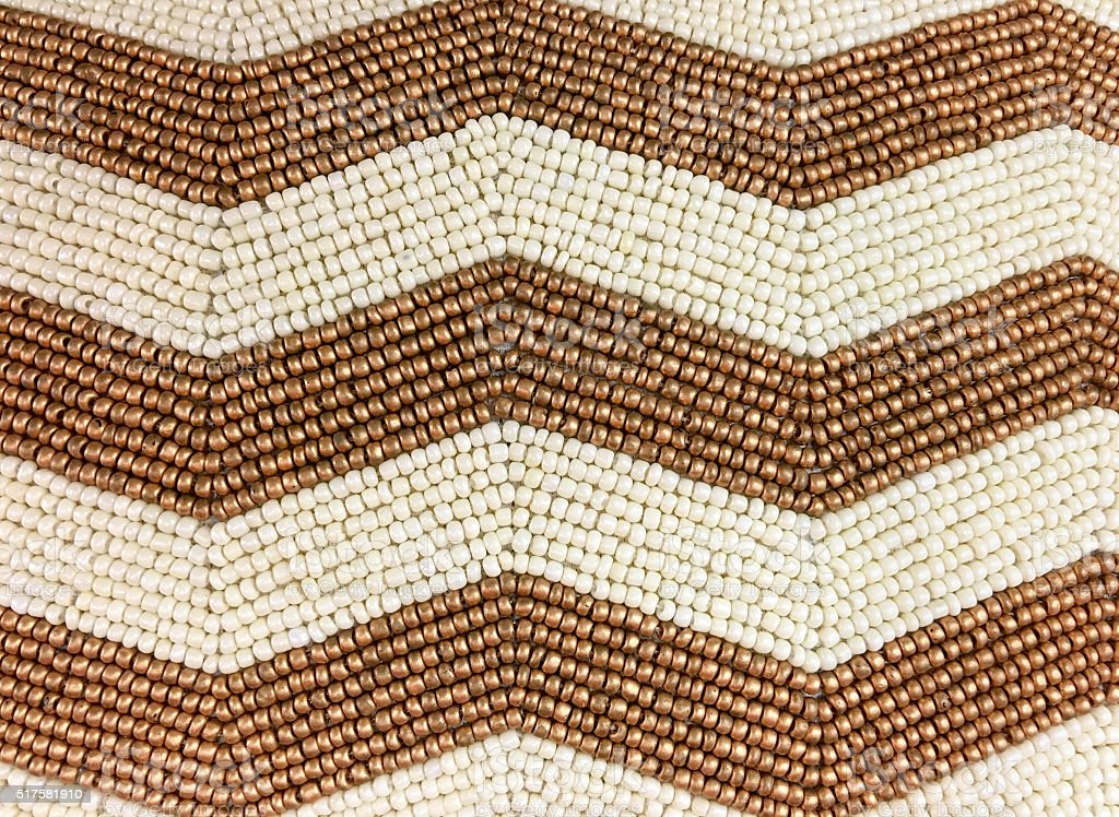 gold and white beads in chevron pattern stock photo