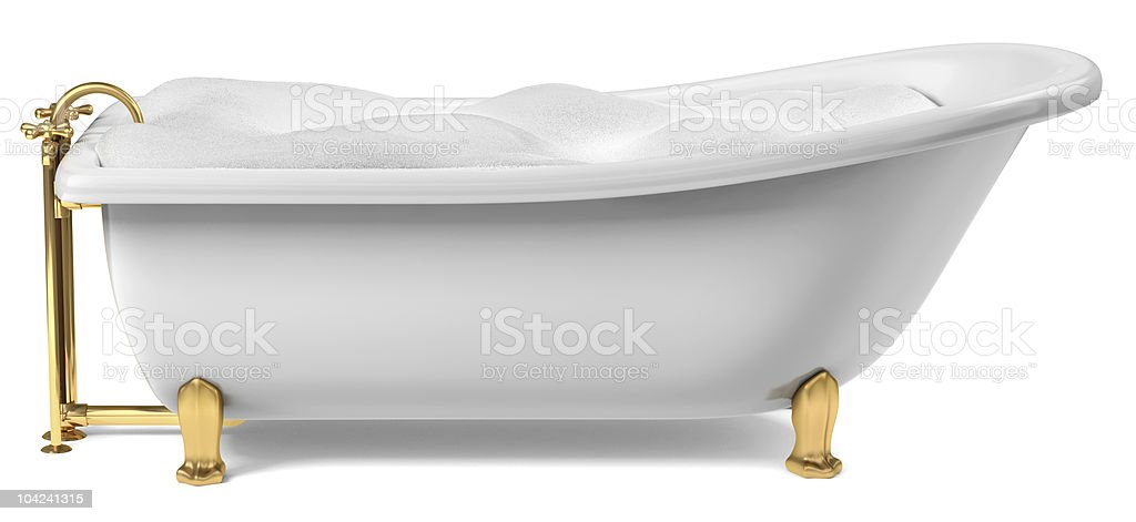 Gold and white clawfoot bathtub filled with bubbles royalty-free stock photo