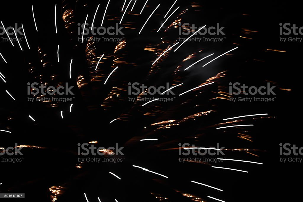 Gold and white fireworks against black sky.  Abstract. royalty-free stock photo