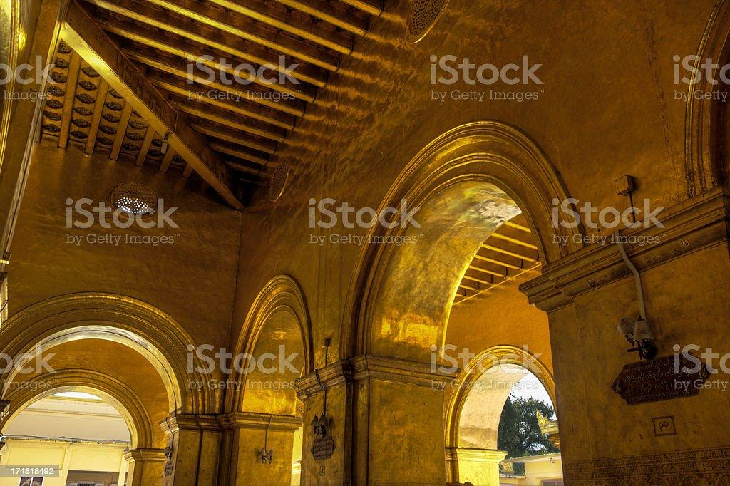 Gold arches in the Maha Myat Muni temple (Mandalay, Myanmar) royalty-free stock photo