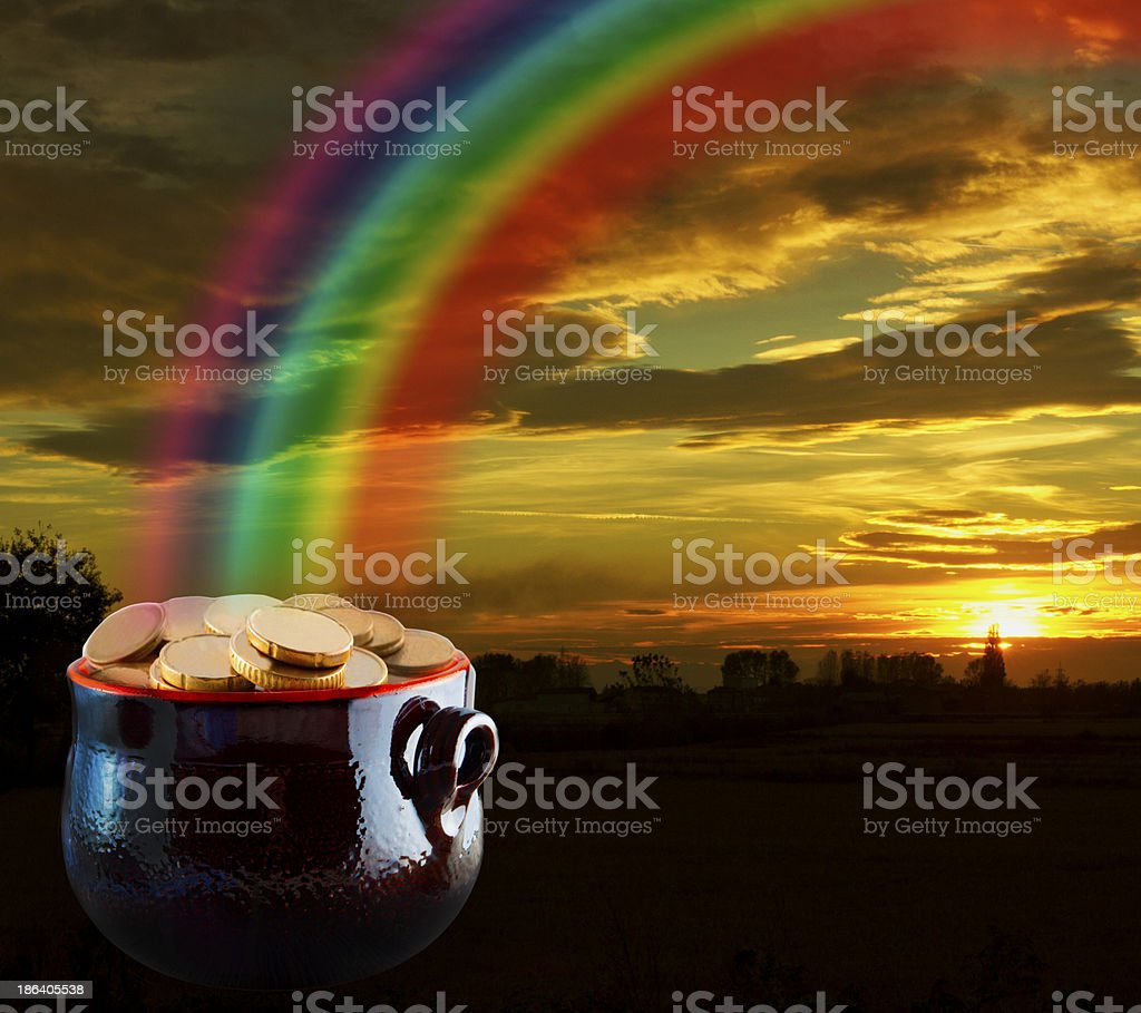 Gold at the end of rainbow stock photo