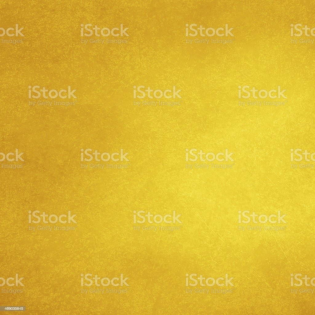 Gold background of varying shades stock photo