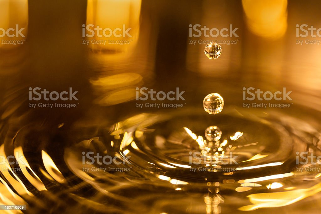 Gold background with reflection and water drops royalty-free stock photo
