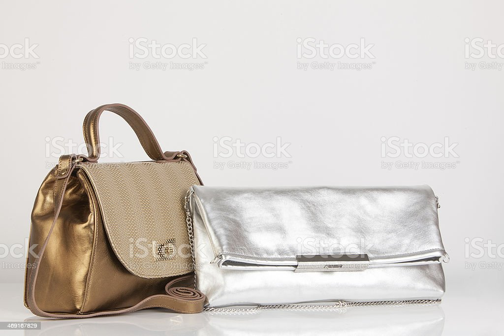 gold bag meets silver clutch royalty-free stock photo