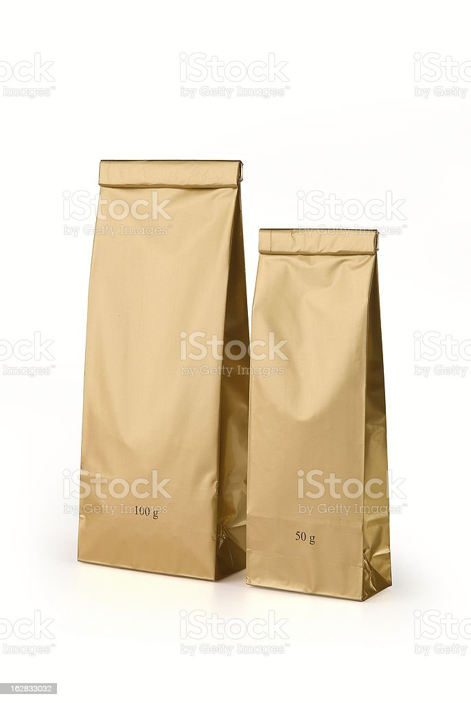 Gold bags for tea stock photo