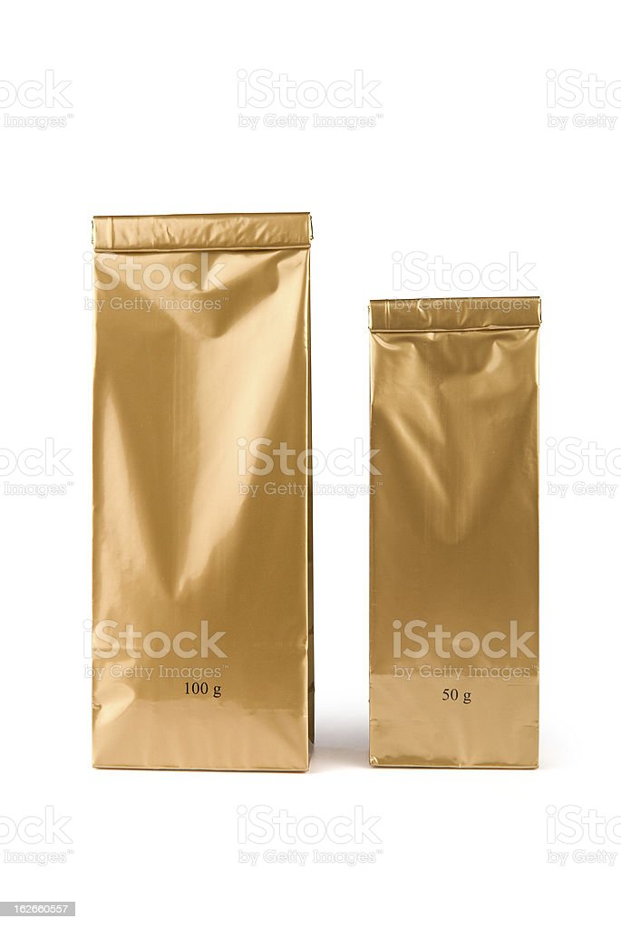 Gold bags sealed with 100g and 50g written on it stock photo