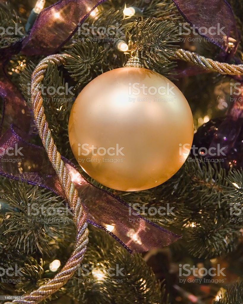 Gold Ball and Cord Ornament royalty-free stock photo