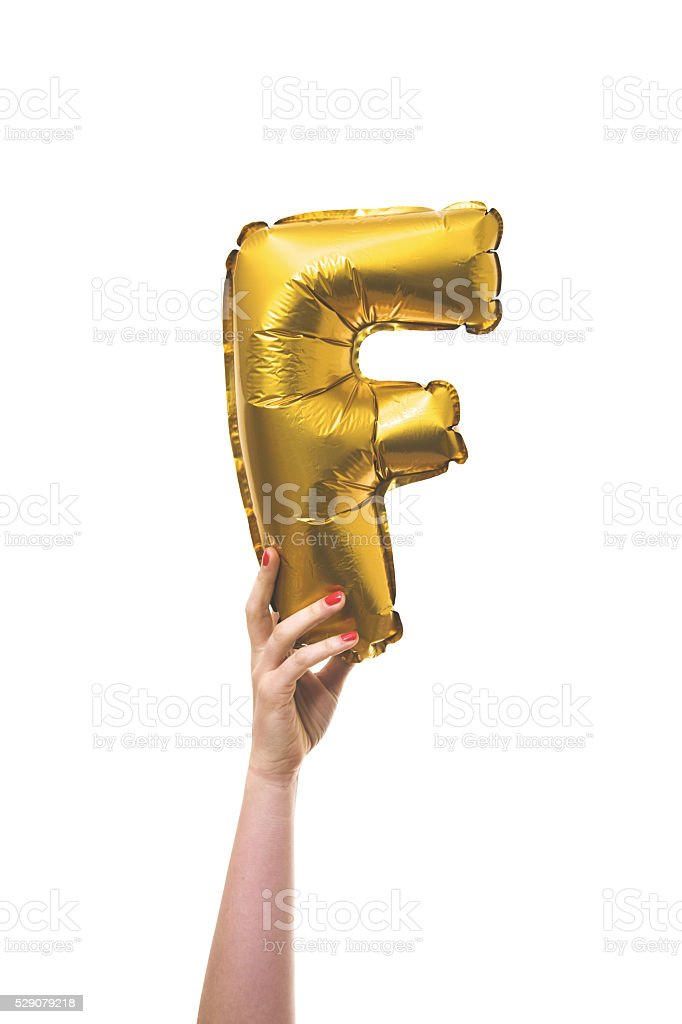 Gold balloon inflatable letter F stock photo