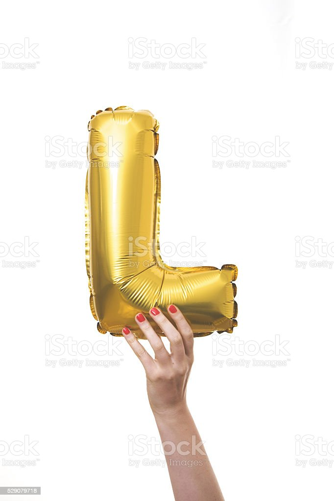 Gold balloon inflatable letter L stock photo