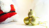 gold balls decoration object with soft focus background santa doll