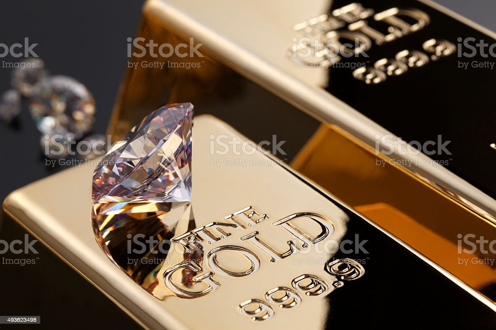 gold bar and diamonds stock photo