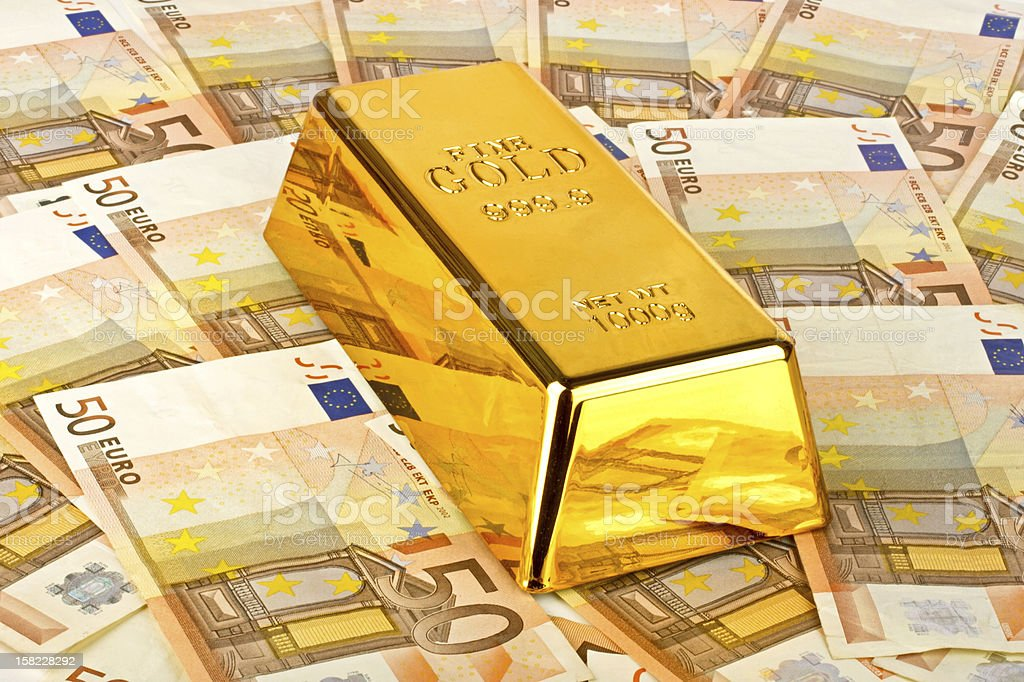 Gold bar and euro money royalty-free stock photo