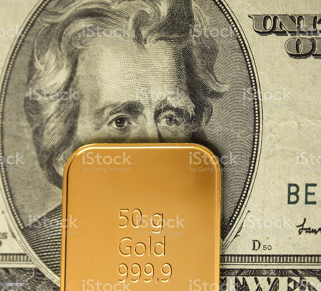 Gold bar ingot on a 20 USD note royalty-free stock photo