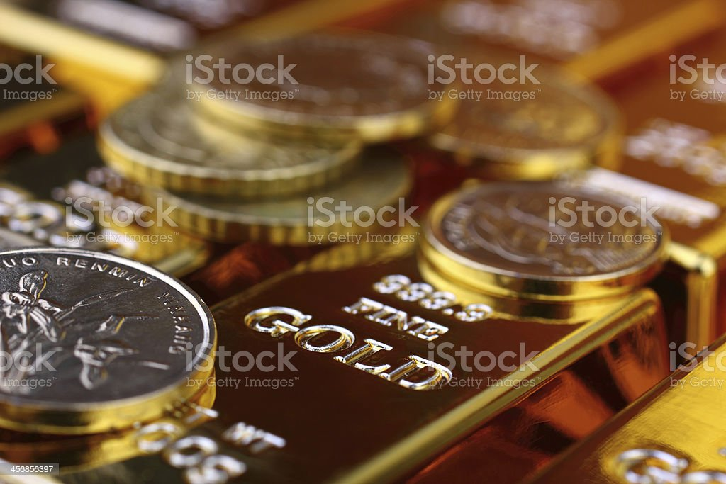 Gold bars and coins for treasury stock photo