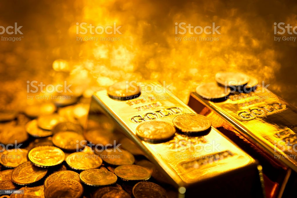 Gold bars and coins stock photo