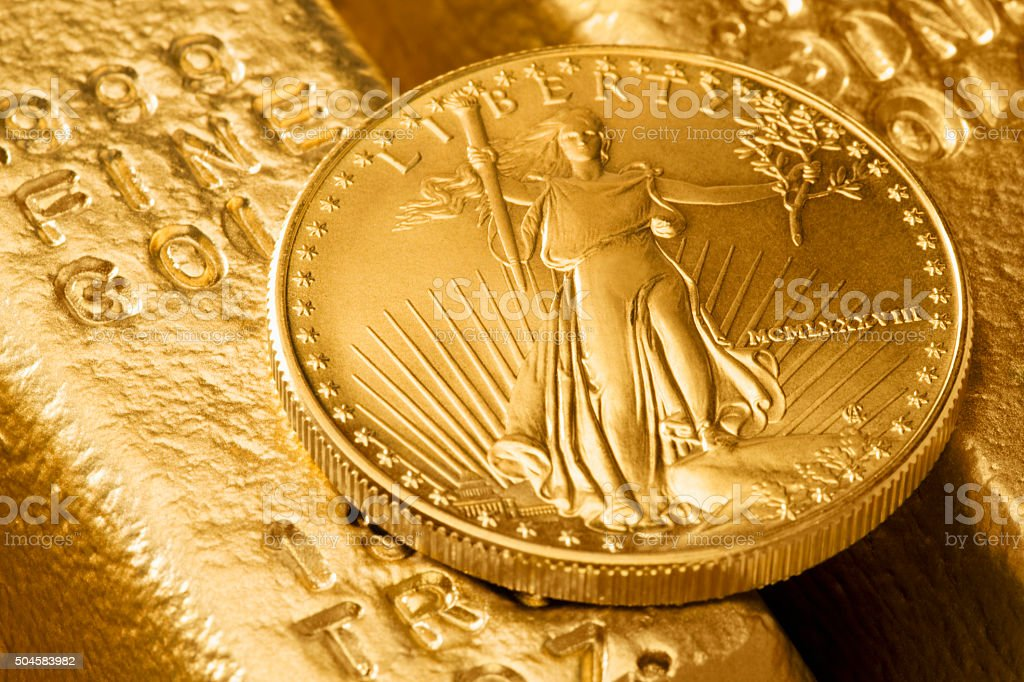 Gold bars and gold coin stock photo