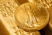 Gold bars and gold coin