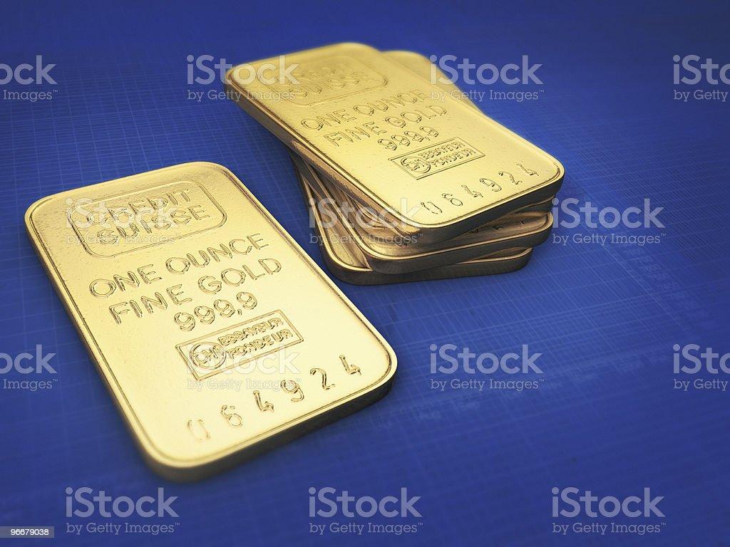 Gold bars on blue background stock photo