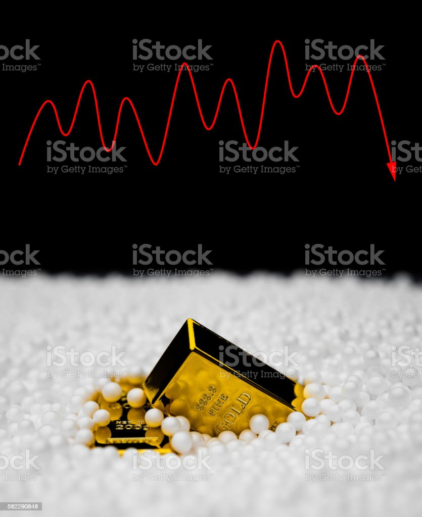gold bars sink into polystyrene particle with a fluctuation stock photo