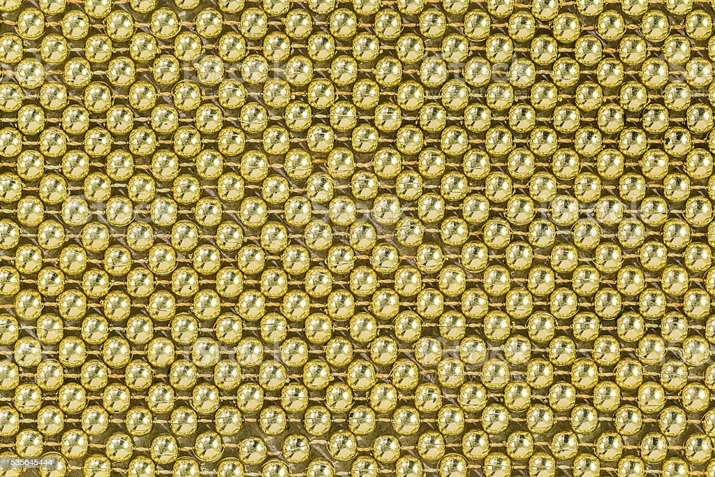 Gold (aureate) bead stock photo