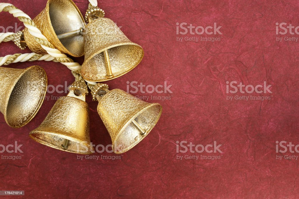 Gold bells on red art paper royalty-free stock photo