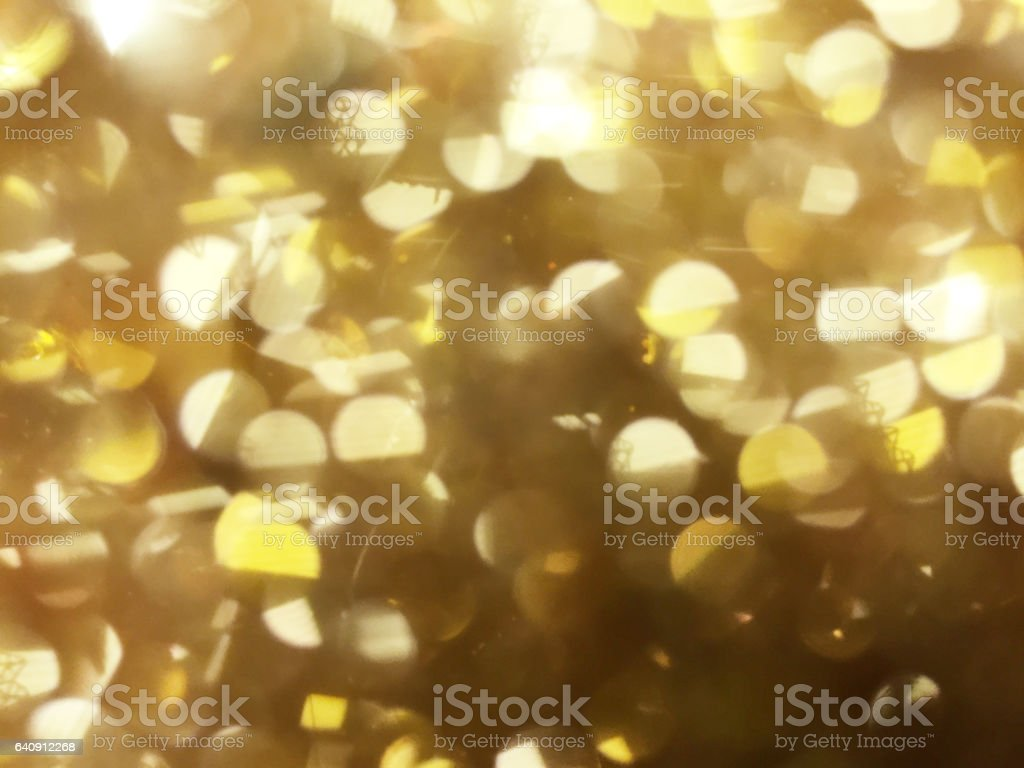 Gold blurred bokeh background stock photo