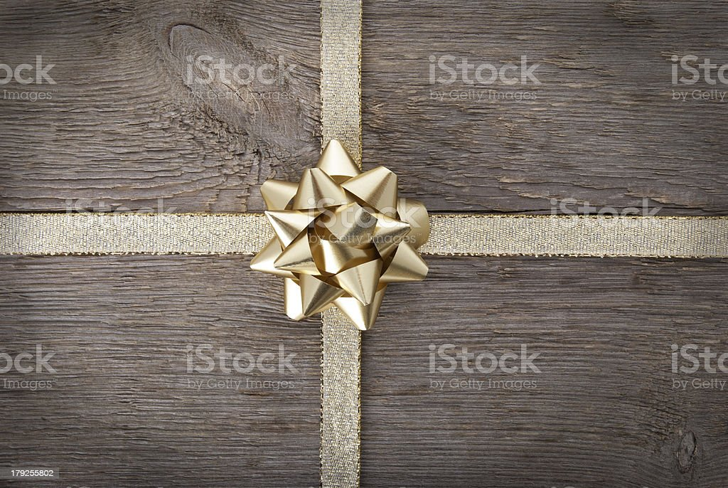 gold bow in the middle of golden ribbon stock photo