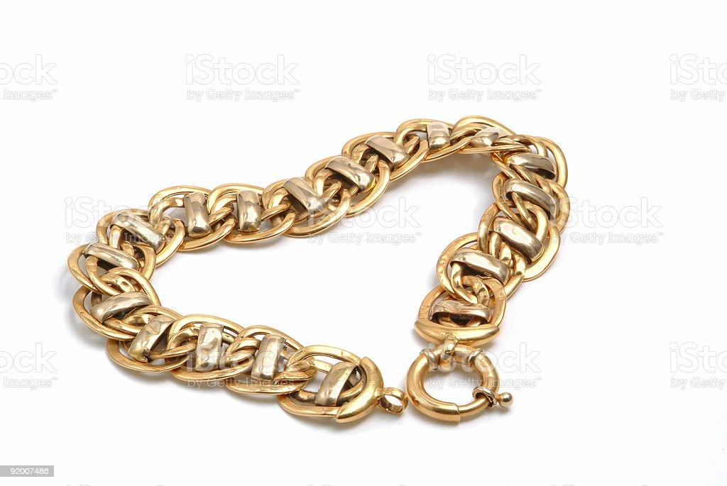 Gold bracelet in heart royalty-free stock photo