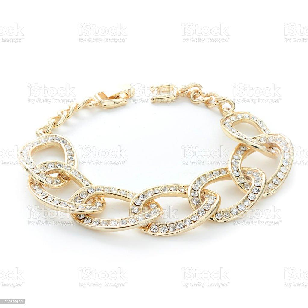gold bracelet with diamonds isolated on white stock photo