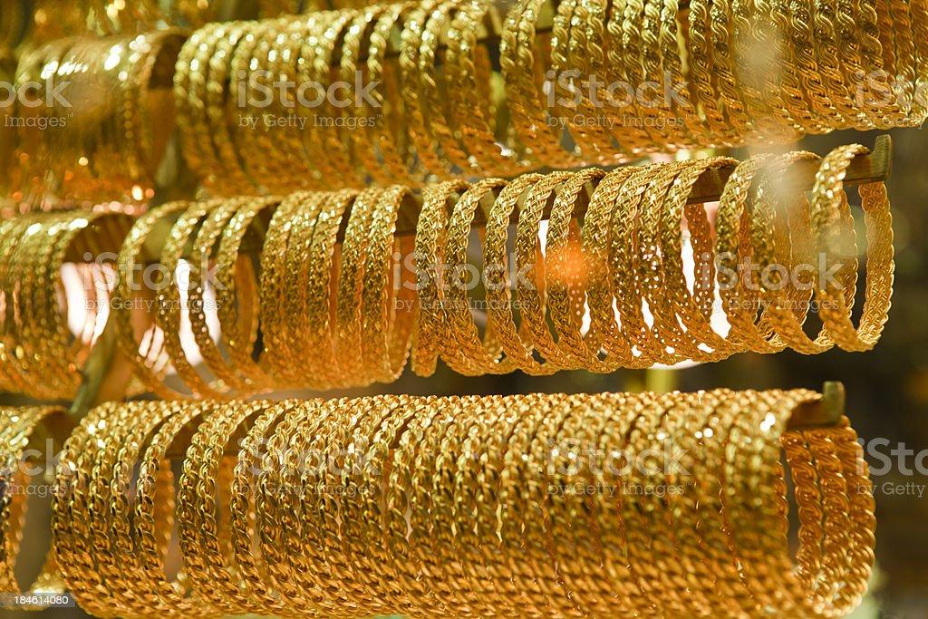 Gold bracelets stock photo