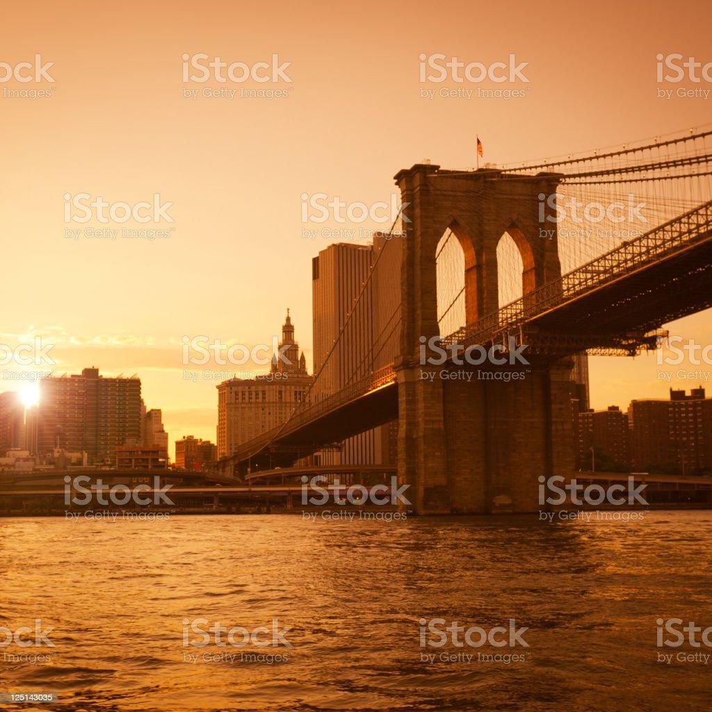 Gold Brooklyn Bridge in Manhattan - NYC royalty-free stock photo