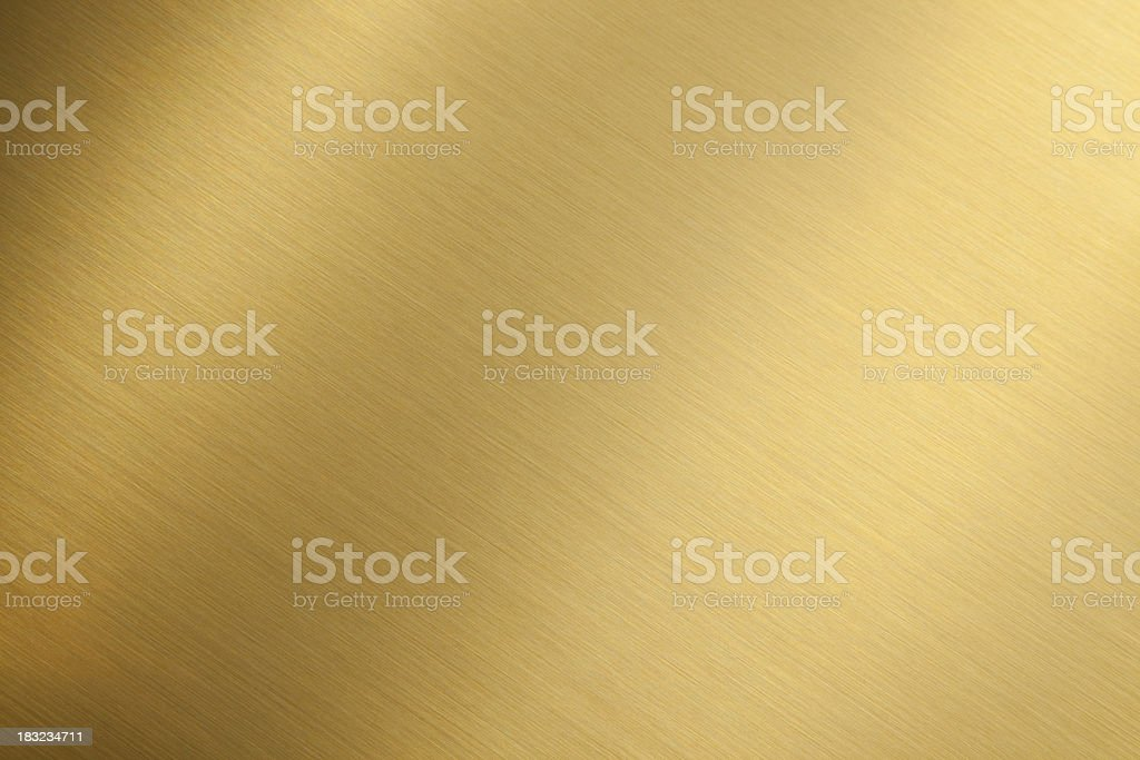 Gold brushed metal texture stock photo